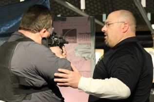 Stephen Link getting pointers for handling an M16.