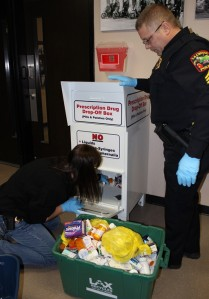 Lt. Avrie Schott and Sgt. Kirk Flatten empty the drug drop box.