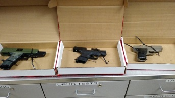 The three hand guns recovered.