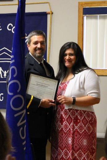 Diana McGrath receives award from Chief Tischer