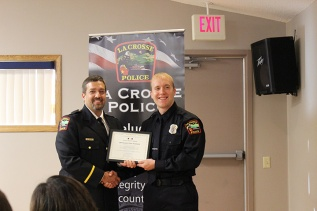 Officer Cody Plenge is presented award by Chief Tischer